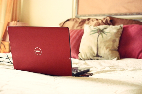 Dell Laptop and Pink and Gold Bedroom Decor